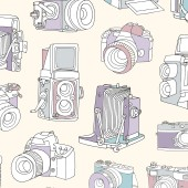 Seamless pattern with film and digital photographic or photo cameras on light background